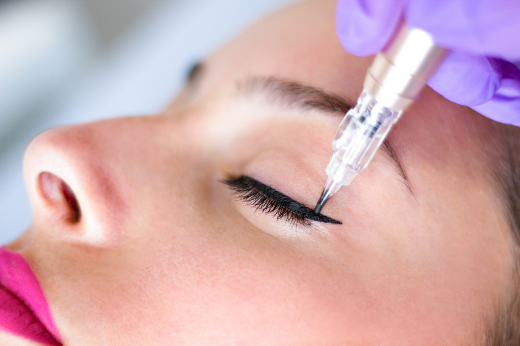 Permanent eyeliner being applied